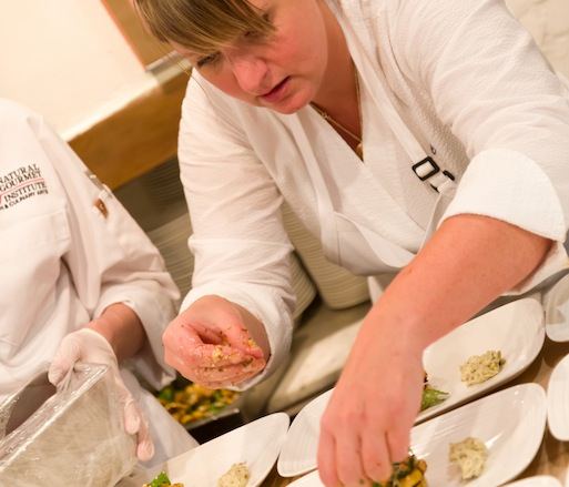 Chef Erin Zircher plating appetizers in the Beard House kitchen